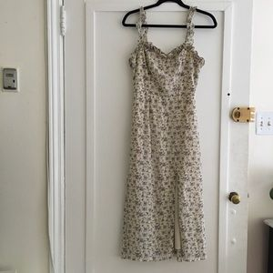 Isalis Parisian floral cream sleeveless midi dress